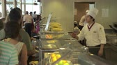 display case : Self service restaurant interior. People waiting in the counter