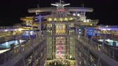 pool deck : Cruise ship promenade deck, boardwalk and pools at night - Harmony of the Seas Stock Footage