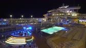 pool deck : Illuminated cruise ship pool deck at night - Harmony of the Seas Stock Footage