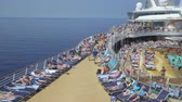 pool deck : Crowded cruise ship pool deck. Passengers sunbathing - Harmony of the Seas Stock Footage