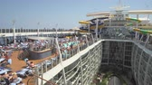 pool deck : Crowd of people in a cruise ship pool deck - Harmony of the Seas, Caribbean sea