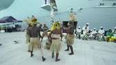 tradicionalmente : Traditionally dressed Haitian dancers show. Caribbean native dance performance