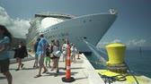 get in : Passengers embark and disembark a big cruise ship in a Caribbean port - Haiti