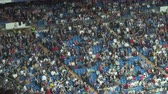 game field : Crowded Santiago Bernabeu football stadium grandstand - April 2018: Madrid, Spain Stock Footage