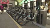 espanhol : Docked bikes in a public bike station. Bicycle docking station - Madrid