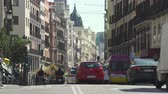 daytime : Traffic in central Madrid. Calle Mayor, busy street scene, cityscape - Spain