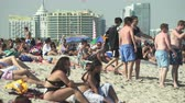 lote : Crowded Miami Beach at spring break time. Beach full of people in a sunny day