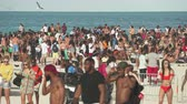 south american : Crowded Miami Beach at spring break time. Beach full of people in a sunny day
