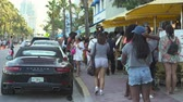 south american : Miami beach cityscape, street view. Students and tourists walking at Ocean dr.