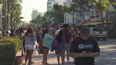 бикини : Miami beach cityscape, street view. Students and tourists walking at Ocean dr.