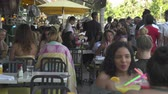 waiter : Miami beach cityscape, street view. Crowded restaurant at Ocean dr. South Beach Stock Footage