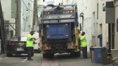 guba : Garbage truck collect the trash in the street - Miami Beach, Florida Stock mozgókép
