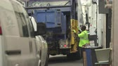 municipal services : Garbage truck collect the trash in the street - Miami Beach, Florida Stock Footage