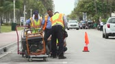 ustabaşı : Construction workers use drilling machine on the street - Miami Beach