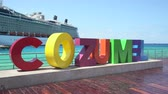 cozumel : Colorful Cozumel sign in the port of Cozumel. Background to a cruise ship - Mexico Stock Footage