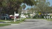 usa : White US mailbox with a suburban neighborhood - Florida Stock Footage