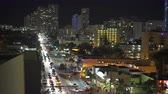 apartment buildings : Aerial shot of Miami cityscape and traffic at night - Miami Beach