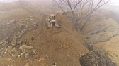 grader : Aerial view of bulldozer working on a construction site - February 2017: Budapest, Hungary
