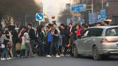 polluted : Traffic in Beijing. Crowd of people on the pedestrian crossing - March 2017: Beijing, China