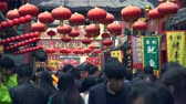 dumanlı sis : Crowded street in Beijing. Crowd of people in Wangfujing snack street, China - March 2017: Beijing, China Stok Video