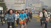 dumanlı sis : Crowd of cyclist in Beijing, China. Chaotic, crowded street scene - March 2017: Beijing, China