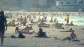 cankurtaran : Crowded tropical beach scene - March 2017: Bondi beach, Sydney, Australia