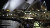 dok : Sydney Opera house and sidewalk with people at night - March 2017: Sydney, Australia Dostupné videozáznamy