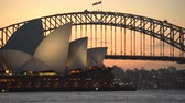 akşam vakti : Stunning view of Sydney Opera House and Harbor bridge at sunset - March 2017: Sydney, Australia
