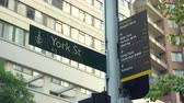 centro da cidade : Sydney, York street sign in downtown - March 2017: Sydney, Australia Vídeos