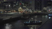 yükleme : Industrial port of Auckland at night. Tug boat is working.