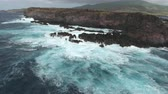 socorro : Aerial shot of ocean waves crashing cliff, steep coastline - Socorro Island