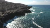 лава : Aerial view of volcanic cliff, steep rocky coastline - San Benedict Island