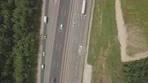 dual : Aerial shot of motorway, freeway traffic - trucks and cars on the road