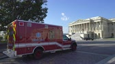 есть : Us Capitol building with ambulance car - Washington DC