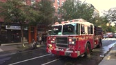 parked : New York fire department fire engine with lights flashing - Manhattan