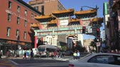 government district : Washington Street street scene, Chinatown gate