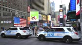 terörist : New York City police cars in the Time Square - Manhattan street scene Stok Video