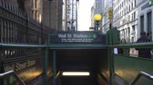 get in : Wall Street subway station entrance on the street. Slider shot - New York, Manhattan