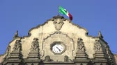 землетрясение : Basilica of Guadalupe clock tower with Mexican flag - Mexico City Стоковые видеозаписи