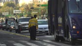 lote : Mexico City street scene with two traffic cops. Overpopulated city