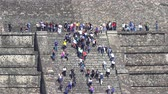 asteca : Teotihuacan moon pyramid with climbing tourists - Mexico City