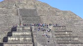 aztek : Teotihuacan moon pyramid with climbing tourists - Mexico City