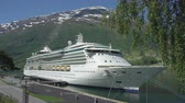 jeż : Cruise ship docked in port of Geiranger fjord - Norway