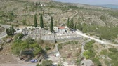 dry season : Aerial view of mediterranean cemetery between the mountains Stock Footage