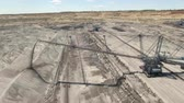 coal mine : Aerial view of bucket wheel excavator in a lignite open pit mine Stock Footage