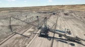 sand pit : Aerial view of an open mine - bucket wheel excavator Stock Footage