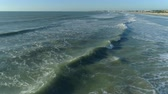 Aerial shot of ocean waves crashing an empty beach. Aerial view of waves, Ocean shore
