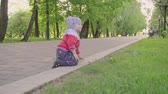 králíček : Adorable toddler boy, child playing on a road with blooming trees on sunset