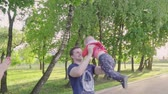 erkekler sadece : Young father playing with his son, throws him up, circling