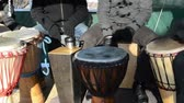 djembe : Drummer musicians group people play with wooden handmade drum outdoor street spring concert event